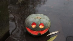Jack-o-lantern in the water Stock Footage