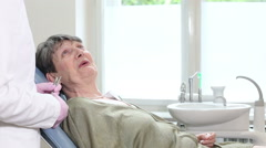 Old woman sitting in dental chair and having routine dental checkup Stock Footage