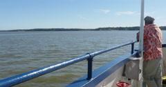 Man Standing on Boat Feeling the Breeze of Wind Crossing River, 4K  Stock Footage