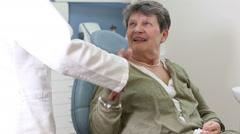 Elderly female patient at dentist ordination having checkup Stock Footage