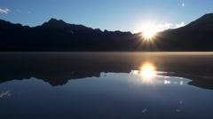 Low Mist and Sundown Reflection over Mountains Moving Timelapse HD Stock Footage