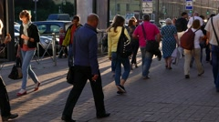 Citizens crowd at walkway, sun beam and shade, people hurry home at work day end Stock Footage
