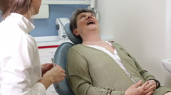 Lovely female dentist doing checkup to elderly female patient Stock Footage