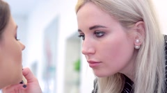 Make-up artist close-up during applying lip pencil Stock Footage