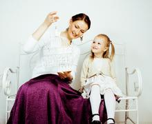 Young mother with daughter at luxury home interior vintage, post card view happy Stock Photos