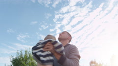 Father and Son Having Fun Outdoors Stock Footage
