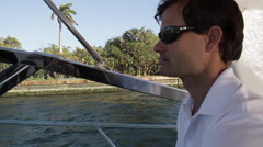 Man driving boat Stock Footage