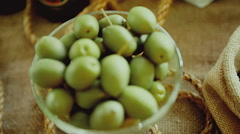 Green olives in bowl Stock Footage