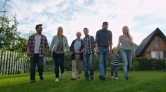 Large Family Walking outdoors Stock Footage