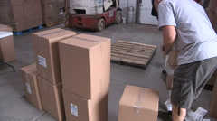 Workers prepare to ship aid to Haiti after hurricane Stock Footage