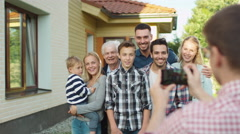 Man Taking Pictures of Large Family Stock Footage