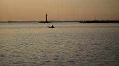 Silhouette of man rows in a boat on water Stock Footage