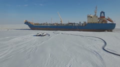 Refueling ship in the Arctic oil terminal Stock Footage