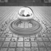 Chrome levitating sphere Stock Illustration