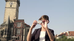 Elegant Cute young business woman takes pictures in the Prague Old Tow Square. Stock Footage