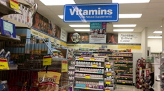 Close up vitamins sign and display health foods inside London drugs store Stock Footage