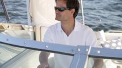 Goodlooking man drives boat Stock Footage