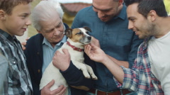 Family Members playing with Dog Stock Footage