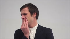 Young businessman with a toothache, Tooth Pain Stock Footage