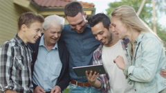 People using Tablet during Family Gathering Stock Footage