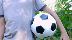 Portrait of a young boy with soccer ball smiling and looking at camera Stock Footage