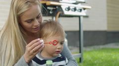 Mother play Son Blow air Bubbles Stock Footage