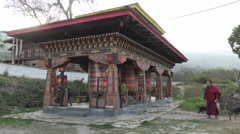 Prayer wheels at Kyichu Lhakhang temple, Bhutan Stock Footage