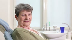 Close up of elderly woman giving thumbs up at dental ordination Stock Footage