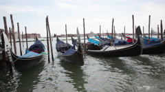 Traditional gondolas of Venice near the pier 05 Stock Footage