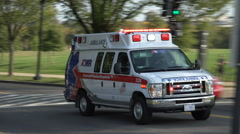 AMR ambulance races past, siren.  DC began using AMR to transport patients with Stock Footage