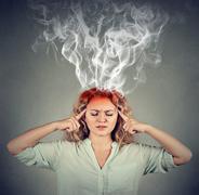 Woman thinks very intensely having headache Stock Photos