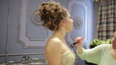 Preens bride before the wedding. powders chestFashion and makeup Stock Footage