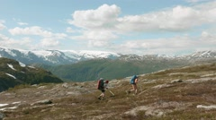 Two backpackers hike in Norway. Stock Footage