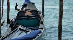 Traditional gondola of Venice near the pier 02 Stock Footage