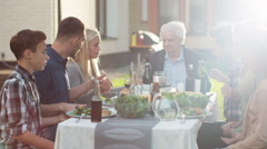 Group of Mixed Race People Joining Hands and Starting to Pray Before Family Dinn Stock Footage