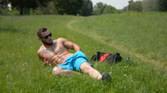 Handsome Muscular Shirtless Hunk Man Outdoor in City Park Stock Footage