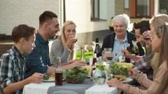 People eating talking during Family Gathering Stock Footage