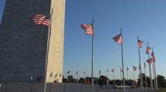 Late sun, Washington Monument with American flags Stock Footage
