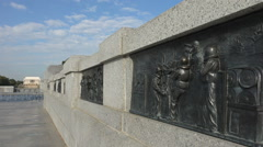Bronze bas relief panel, WW II Memorial, depicts naval ship anti-aircraft Stock Footage