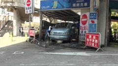 Two people are cleaning a van in a car wash, located in the Taipei city, Taiwan. Stock Footage
