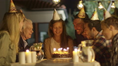 Happy Smiling Girl Blowing Candles out on her Birthday Cake. Girl Surrounded by  Stock Footage