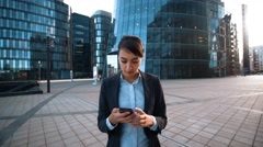 Businesswoman give You mobile phone. Big deal calling Stock Footage