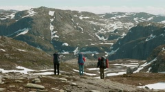Three friends in the Norwegian mountains. Stock Footage