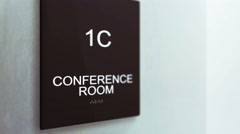Conference Room Sign CU in an ambient Corporate Office Hallway Sett Stock Footage