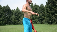 Strong sportsman doing exercises outdoor Stock Footage