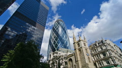 Gherkin building and city skyline on a sunny day. London, United Kingdom. Stock Footage