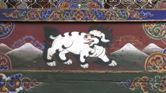 Snow lion painting at Kyichu Lhakhang temple, Bhutan Stock Footage