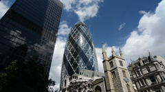 Gherkin building and city skyline on a sunny day. London, United Kingdom. Zoom Stock Footage