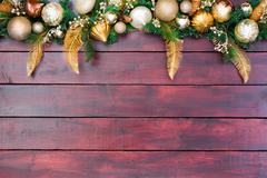 Pretty Christmas border wreath atop wood Stock Photos