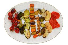 Top down view of oval plate with grilled veggies Stock Photos